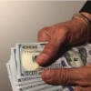 Oltiariqda kadastr xodimi 30 ming AQSh dollari talab qildi